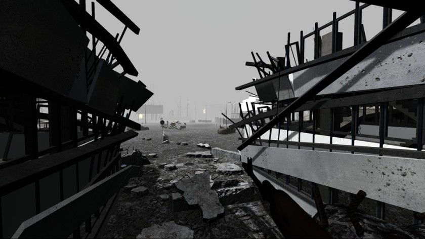 A desolate scene, mostly in grey tones. To the right and to the left are ruins of concrete and steel. In the foggy distance is rubble, lamp posts and gunfire.